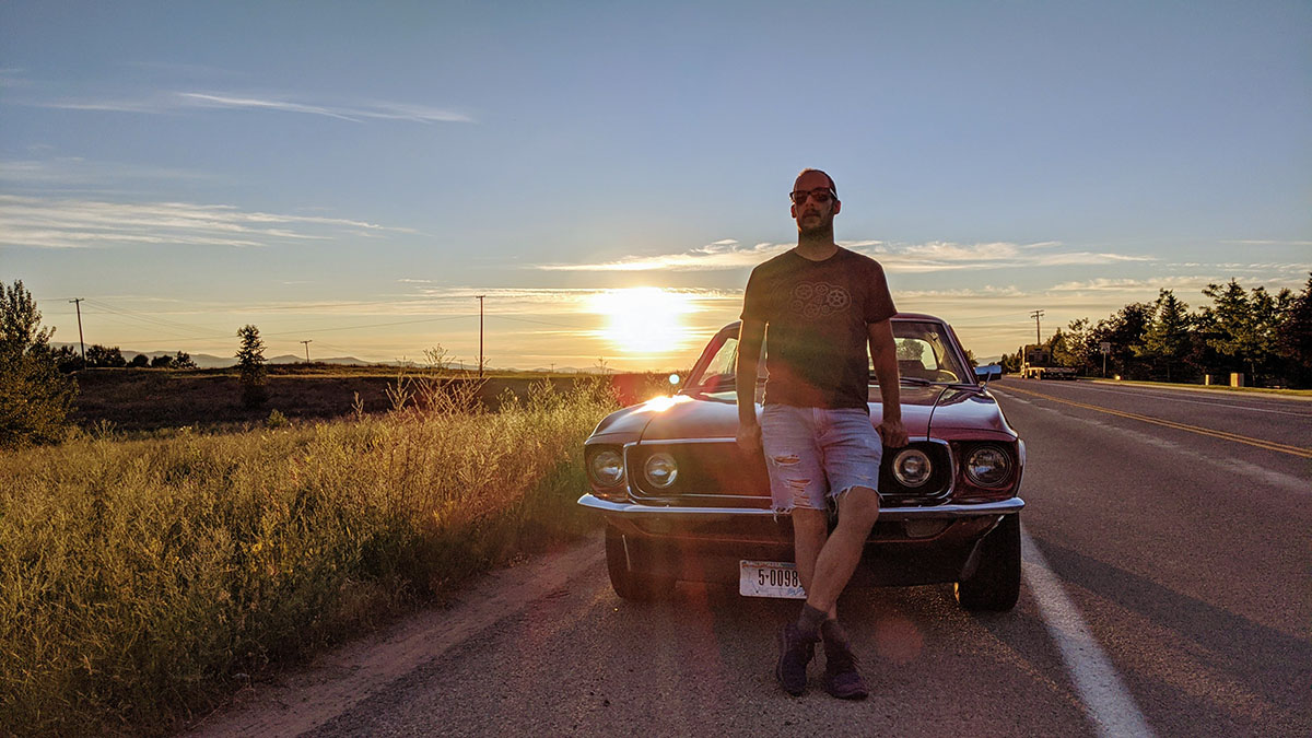 Montana - Michael Makarov is posing by his friend's car.